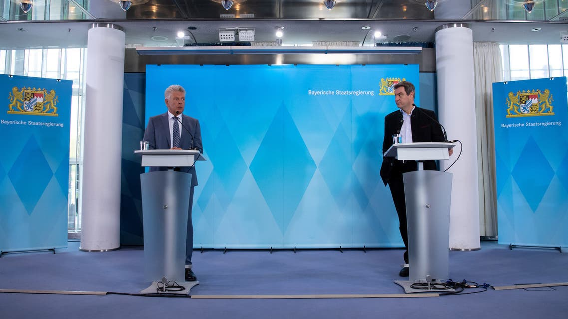 Bavarian State Prime Minister Markus Soeder and Munich mayor Dieter Reiter speak about cancelation of the Oktoberfest amid the coronavirus during a press conference in Munich. (Reuters)