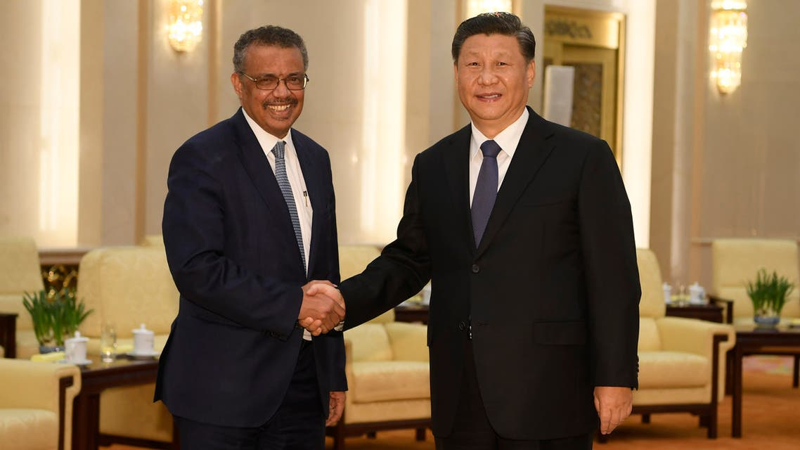 World Health Organization director general Tedros Adhanom (L) shakes hands with Chinese President Xi Jinping at the Great Hall of the People in Beijing on January 28, 2020. (AFP)