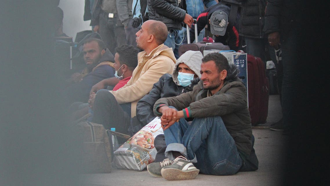 Tunisian workers who were stranded in Libya are pictured as they return to Tunisia at the Ras Jedir border post on April 20, 2020.  (AFP)