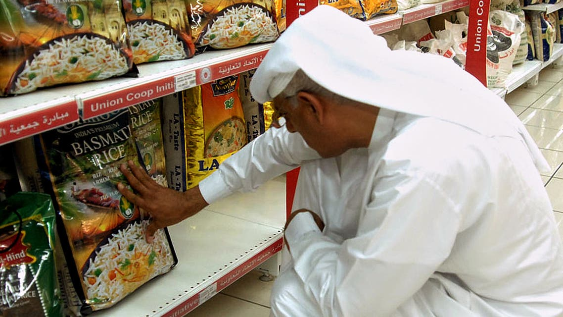 An Emirati man reads the front of a package of Indian Basmati rice in a supermarket in Dubai on July 19, 2008. (AFP)