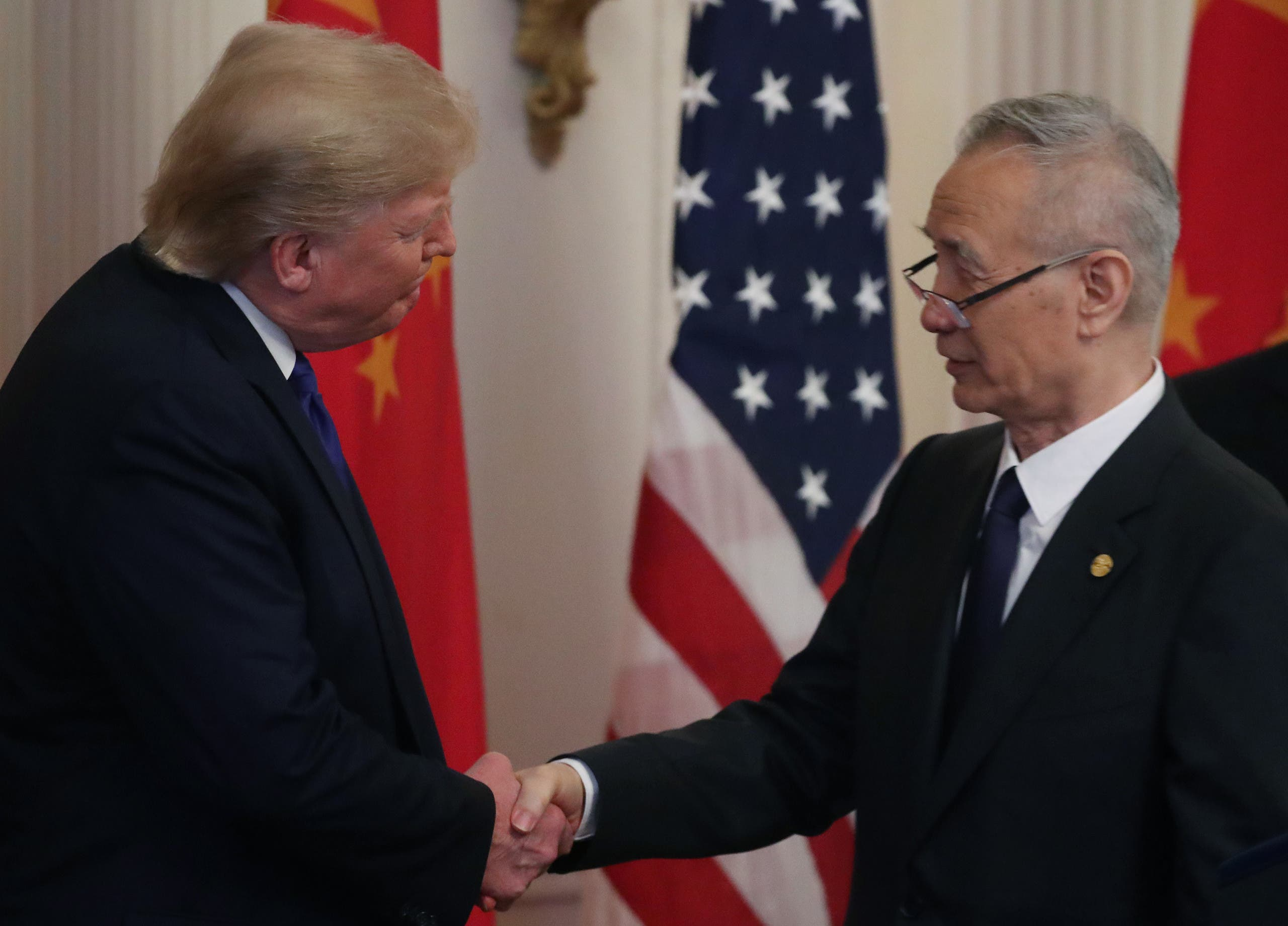 President Donald Trump shakes hands with Chinese Vice Premier Liu He, before signing the phase 1 of a trade deal, at the White House, on January 15, 2020 in Washington, DC. (AFP)