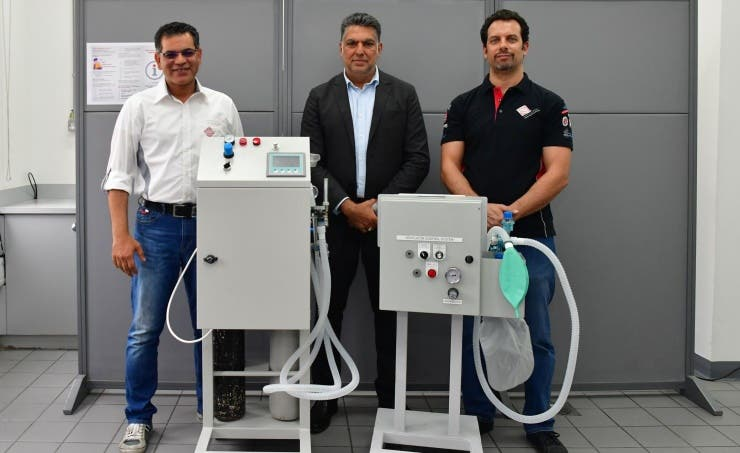 Bahrain International Circuit engineers pictured with one unit of the newly designed breathing aid. (BNA)