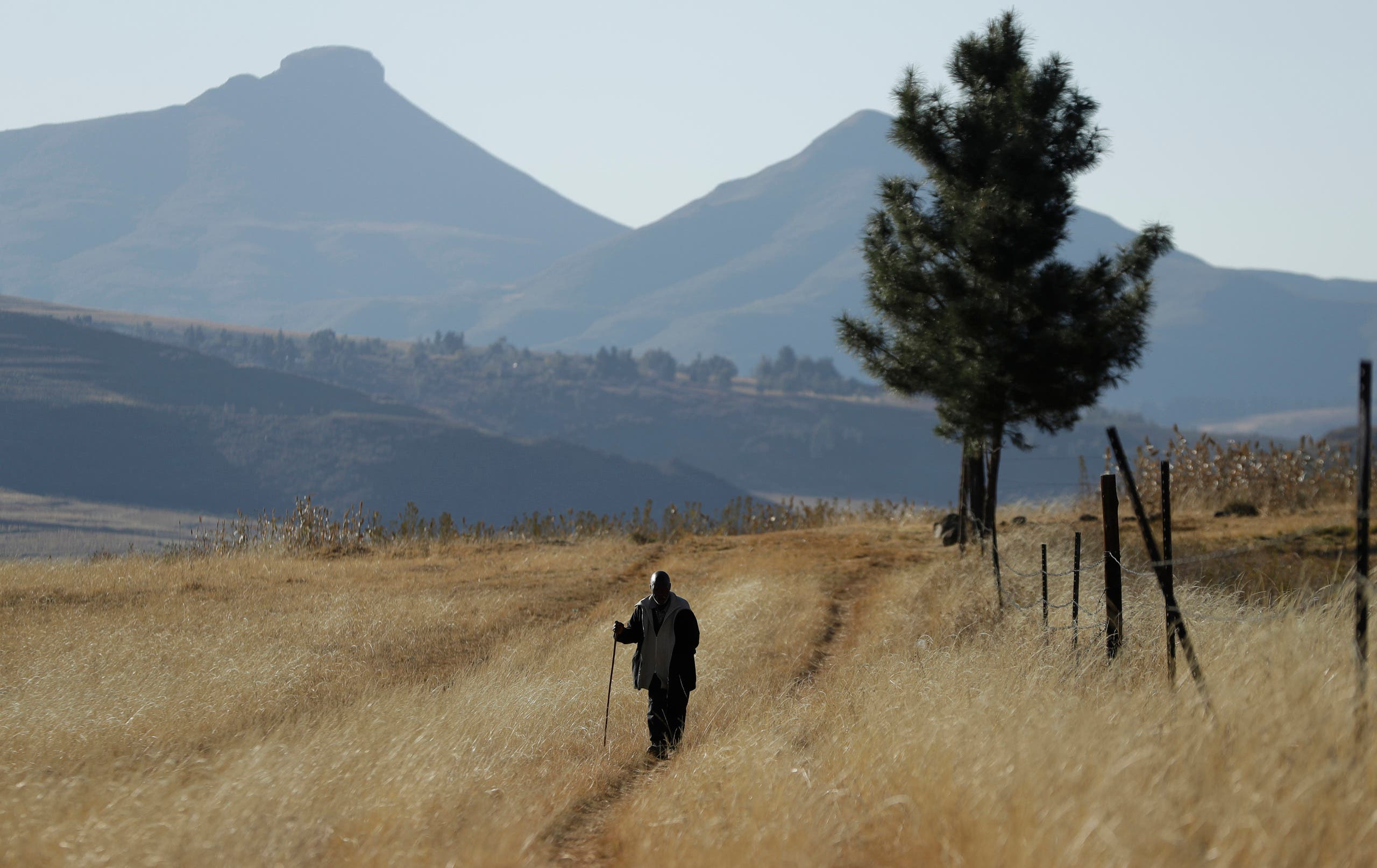 A man walks on the land at Ha Mampho village, in Lesotho on June 3, 2017. (AP)