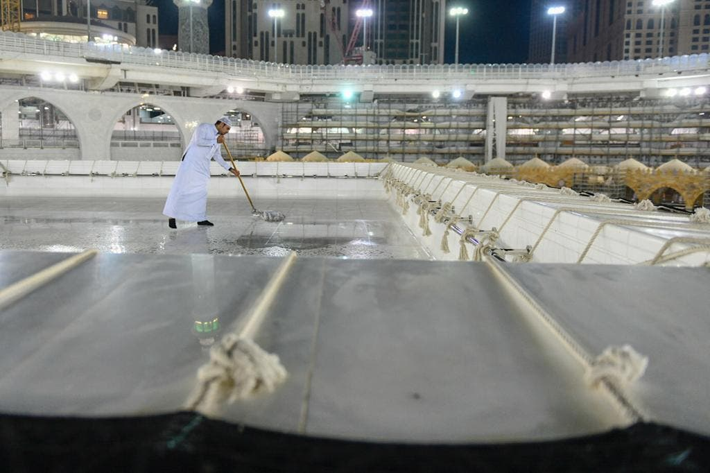 The General Presidency for the Affairs of the Two Holy Mosques's team cleans and sterilizes the cover (Kiswa) and surface of the Holy Kaaba in Mecca, Saudi Arabia, April 21, 2020. (Twitter) 6
