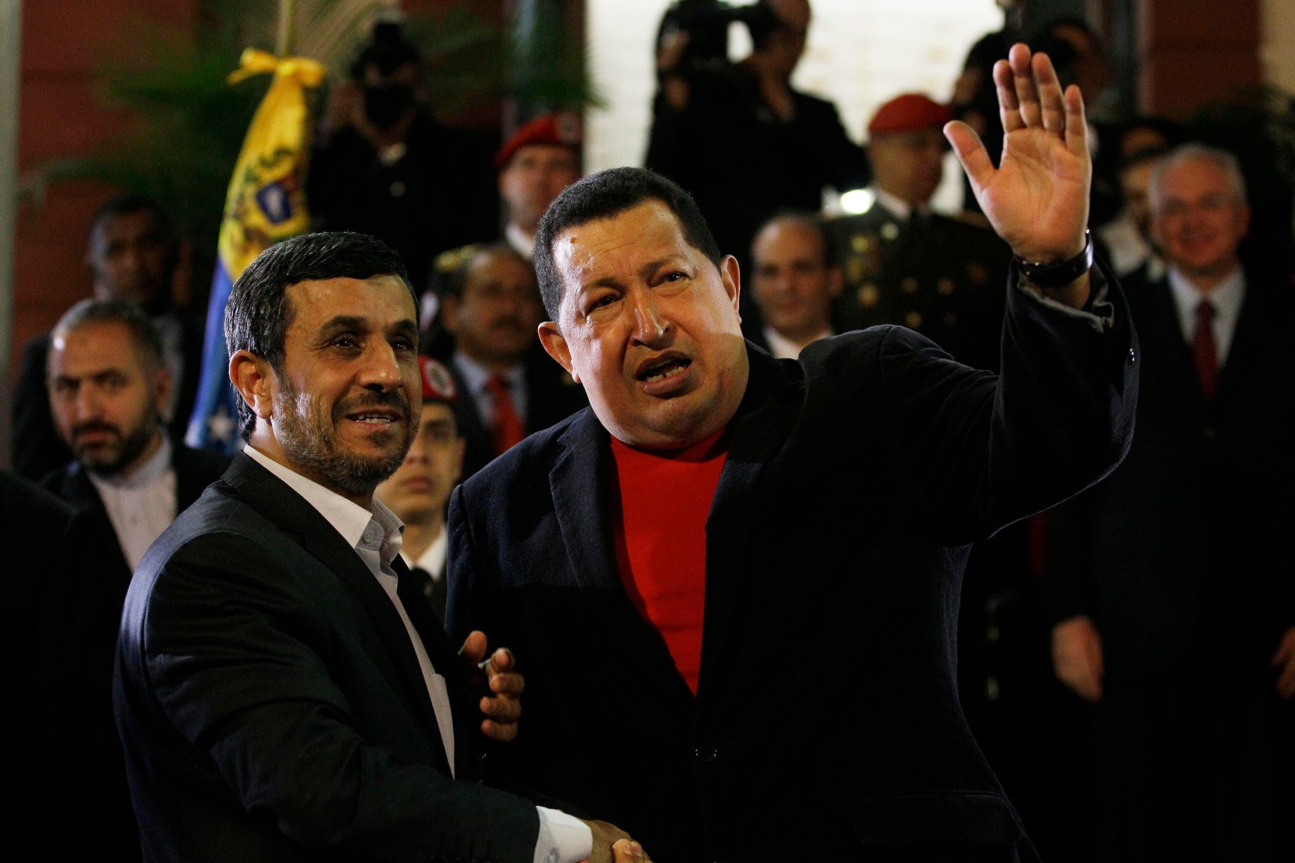 Iran's President Mahmoud Ahmadinejad, left, shakes hands with Venezuela's President Hugo Chavez as he arrives to Miraflores presidential palace in Caracas, Venezuela on June 22, 2012. (AP)