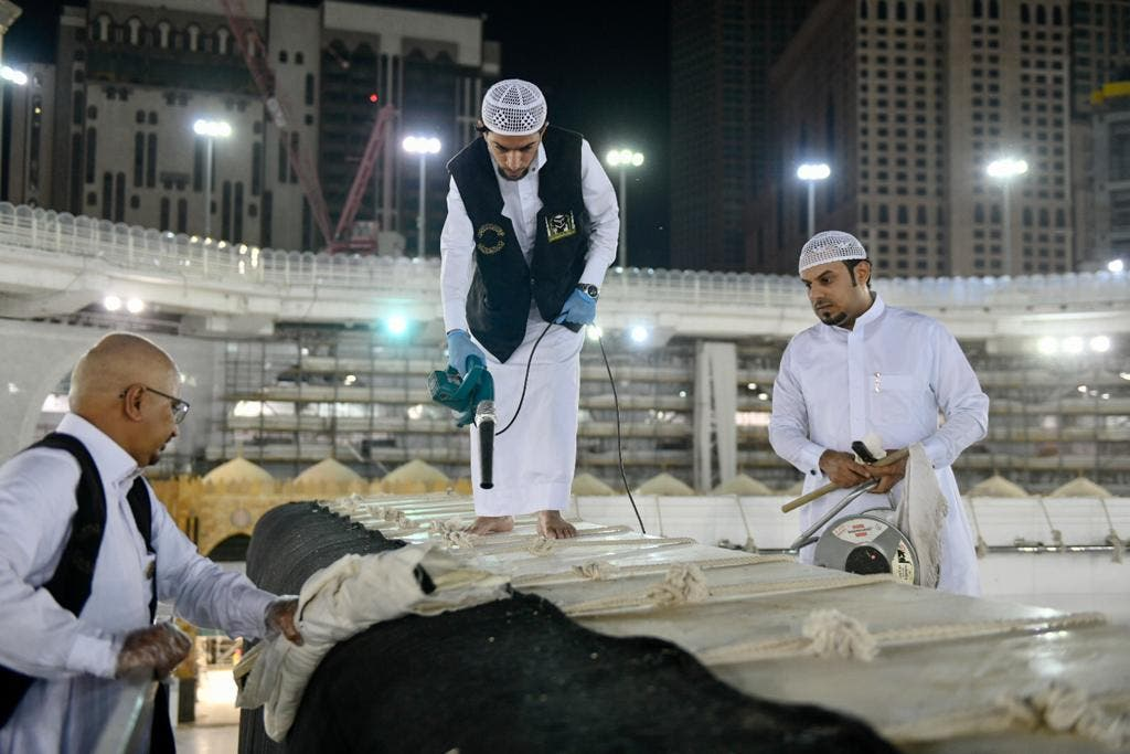 The General Presidency for the Affairs of the Two Holy Mosques's team cleans and sterilizes the cover (Kiswa) and surface of the Holy Kaaba in Mecca, Saudi Arabia, April 21, 2020. (Twitter) 5
