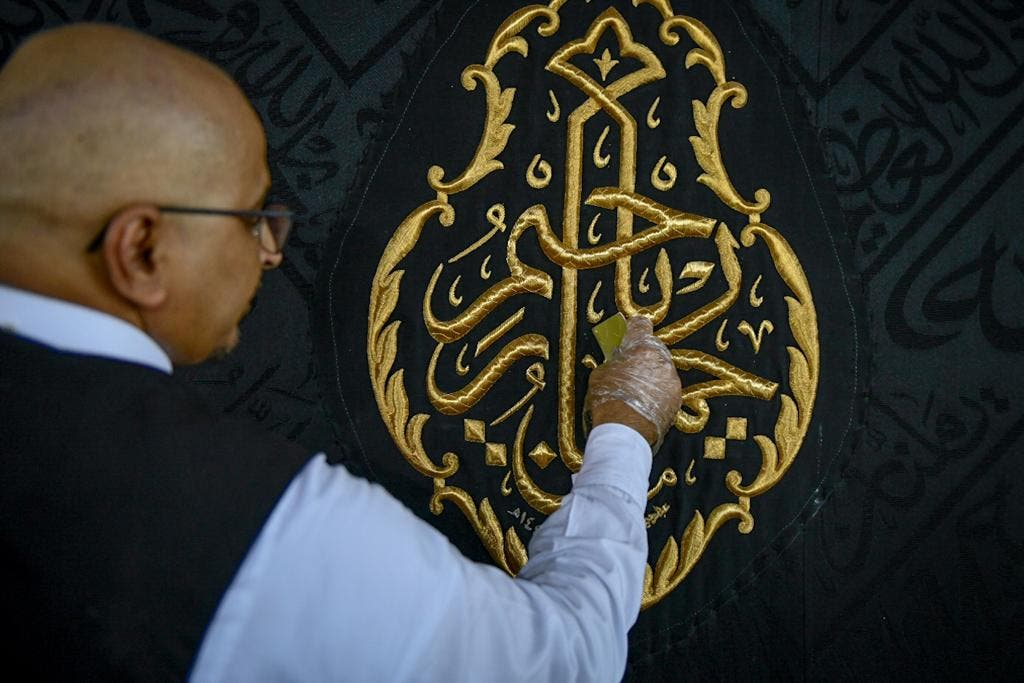 The General Presidency for the Affairs of the Two Holy Mosques's team cleans and sterilizes the cover (Kiswa) and surface of the Holy Kaaba in Mecca, Saudi Arabia, April 21, 2020. (Twitter) 4