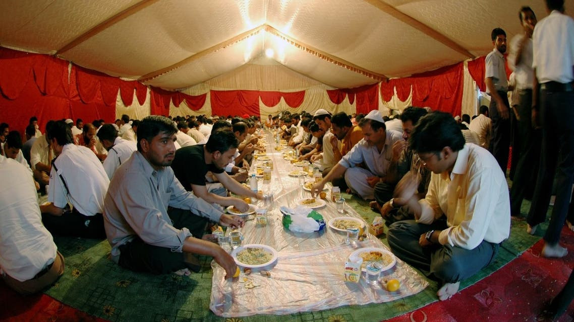 Muslim labourers and workers prepare to break their fast, during the Muslim Holy month of Ramadan, in a charity tent set up to offer free iftar meals to poor working labourers in one of the residential areas in Dubai, UAE. (File photo: Reuters)
