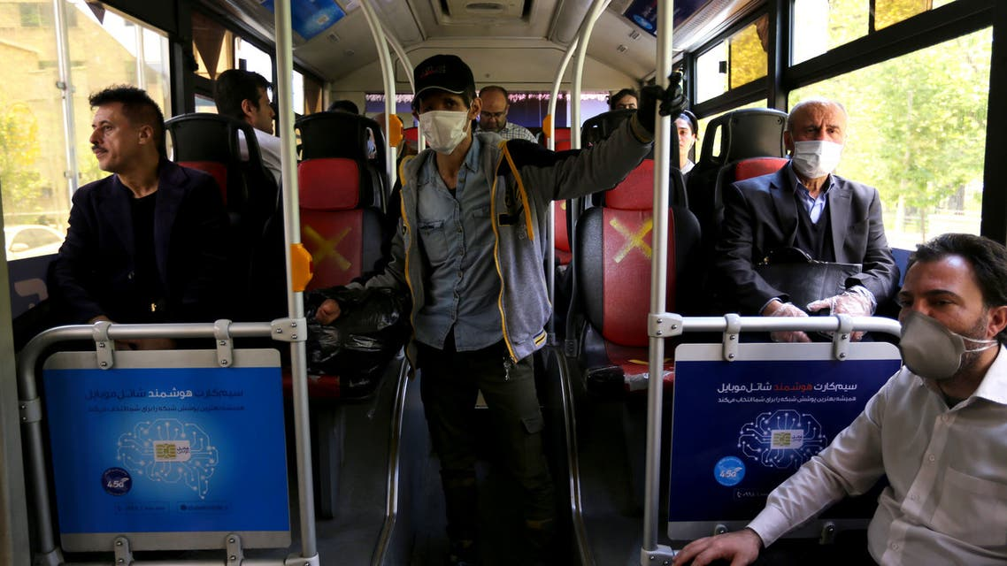 Iranian men keep distance from each other while waiting for the bus in Tehran on April 21, 2020 amid the coronavirus COVID-19 pandemic. Iran yesterday reported 91 new deaths from the novel coronavirus, as the government allowed more economic activity to resume after a gradual reopening in the past 10 days. After nearly a week of declining fatalities, there has been a slight uptick in the past few days for the Islamic republic, one of the world's hardest hit.