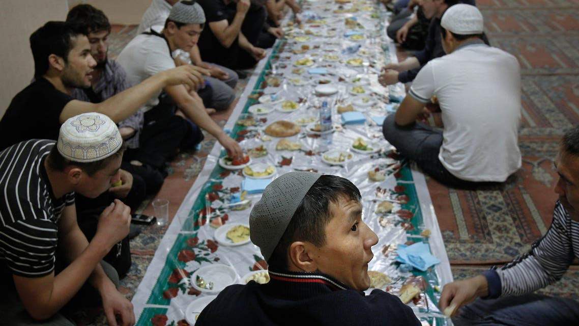 Migrant workers sit for a meal after prayers on the first day of Ramadan in a mosque in Moscow. (Reuters)