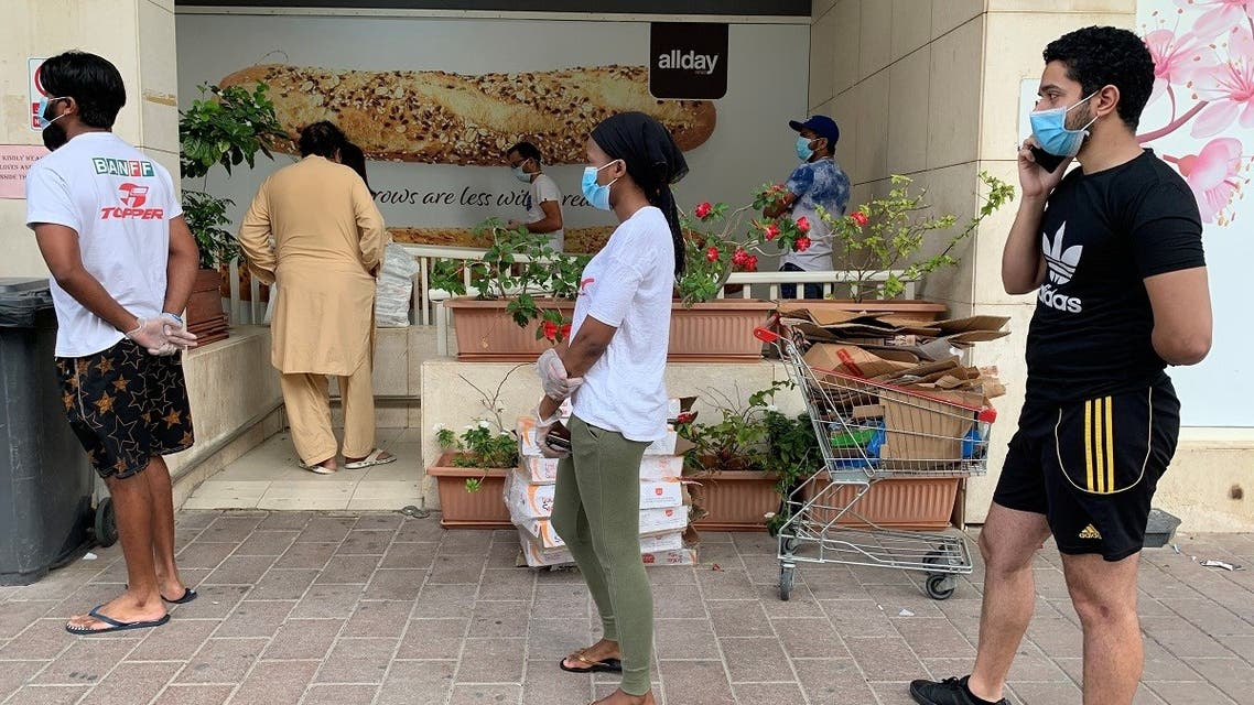 People keep distance in a line outside a supermarket to prevent the spread of the coronavirus disease (COVID-19) in Dubai, United Arab Emirates. (Reuters)