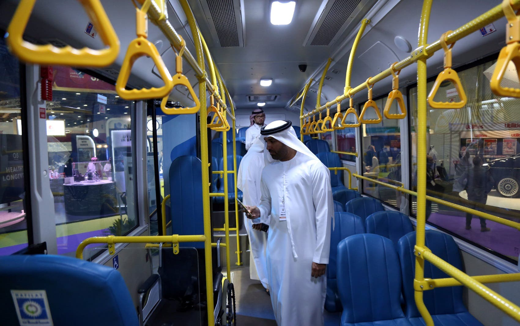 Visitors take a look at the interior of the ECO Bus manufactured by Masdar during the Abu Dhabi Sustainability Week, in Abu Dhabi, UAE, January 17, 2018. (File photo: Reuters)