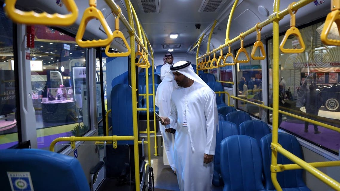 Visitors take a look at the interior of the ECO Bus manufactured by Masdar during the Abu Dhabi Sustainability Week, in Abu Dhabi, UAE, January 17, 2018. (Reuters)