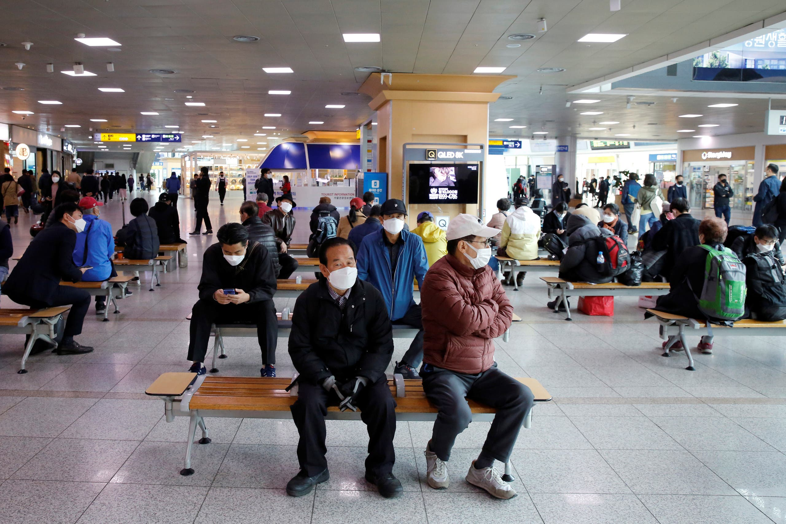 People wearing face masks to protect against contracting the coronavirus disease (COVID-19), wait at the Seoul Railway Station in Seoul, South Korea, April 21, 2020. (Reuters)