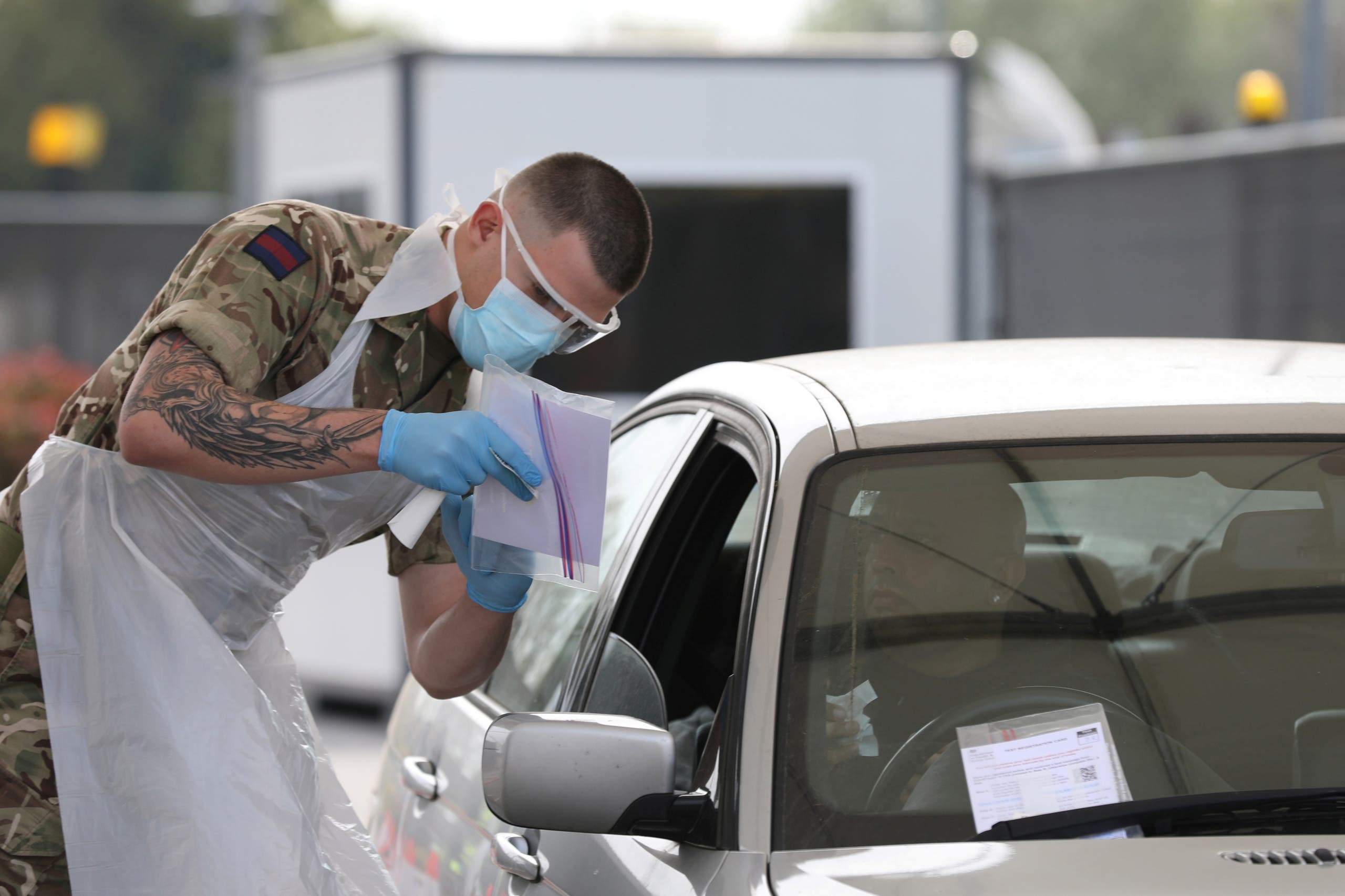 A soldier helps conducting COVID-19 testing for NHS key workers at a testing site in Wembley, London, amid the coronavirus disease (COVID-19) outbreak in Britain, April 16, 2020.