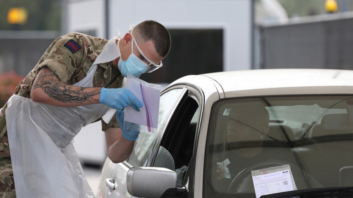 A soldier helps conducting COVID-19 testing for NHS key workers at a testing site in Wembley, London, amid the coronavirus disease (COVID-19) outbreak in Britain, April 16, 2020. UK Ministry Of Defence/Crown Copyright 2020/Handout via REUTERS THIS IMAGE HAS BEEN SUPPLIED BY A THIRD PARTY. MANDATORY CREDIT. NO RESALES. NO ARCHIVES