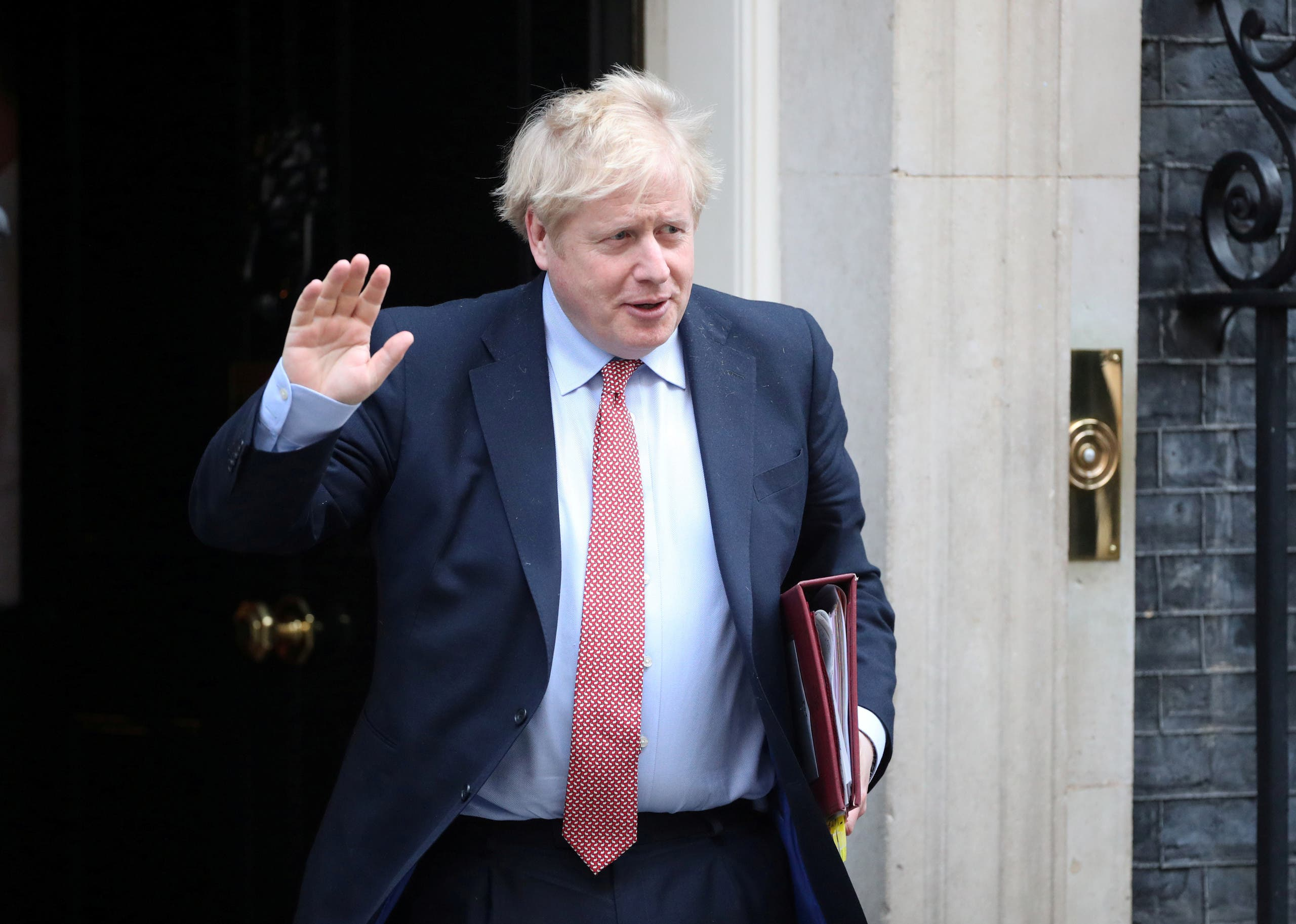 Britain's Prime Minister Boris Johnson waves as he leaves Downing Street in. London, Britain on March 25, 2020. (Reuters)