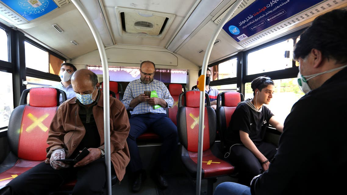 Iranian men keep distance from each other while waiting for the bus in Tehran on April 21, 2020 amid the coronavirus COVID-19 pandemic. (File photo)