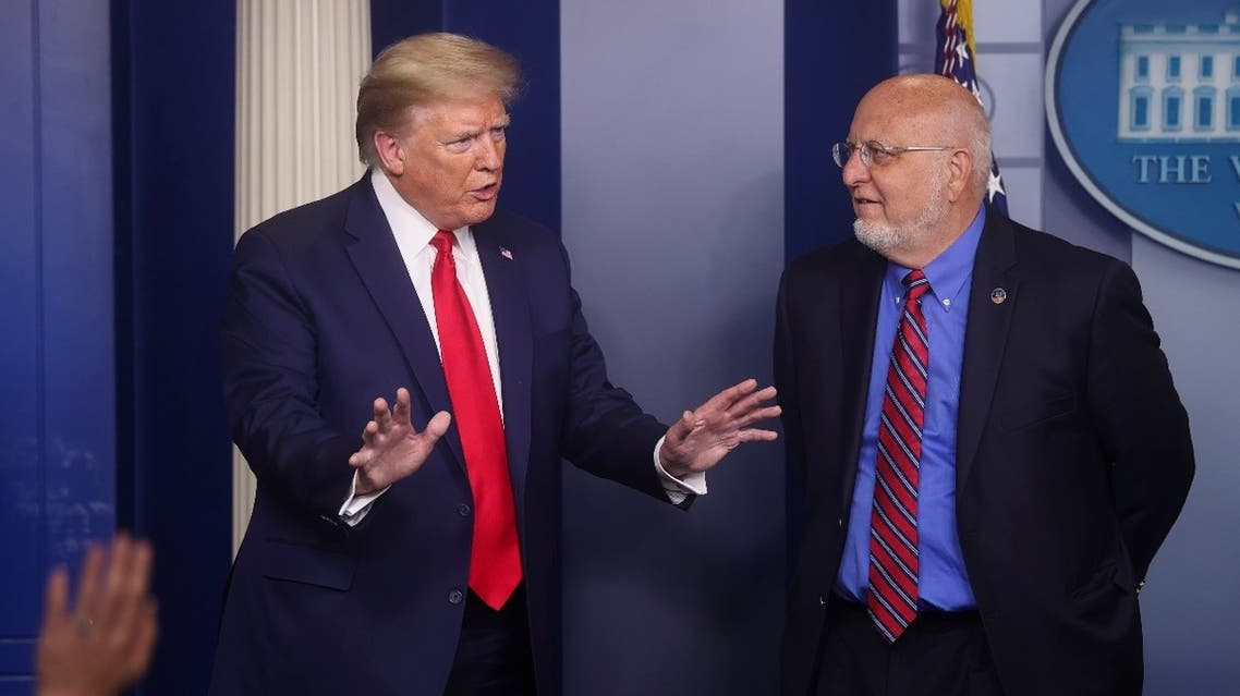 US President Donald Trump reacts to a reporter's question as Centers for Disease Control (CDC) Director Robert Redfield answers questions at the daily coronavirus task force briefing at the White House in Washington, US, April 22, 2020. (Reuters)