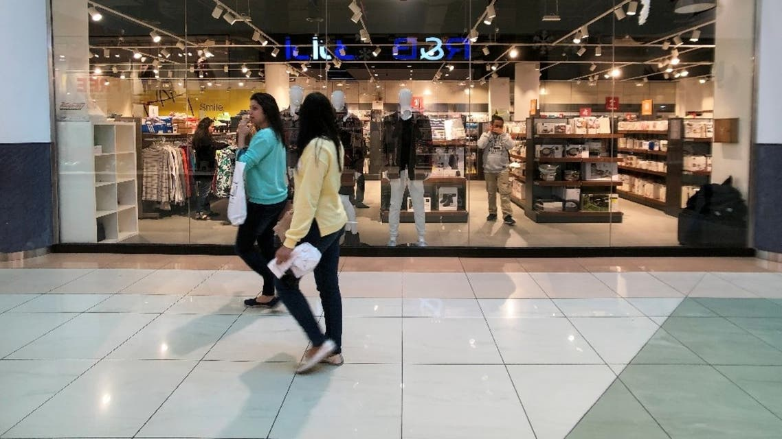 Shoppers walk in front of a fashion discounted multi-brand store, in Wahda Mall in Abu Dhabi, United Arab Emirates. (File photo: Reuters)
