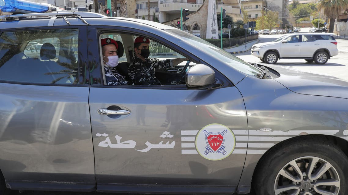 Police officers wearing face masks patrol in the Lebanese capital Beirut to help enforce the government's order for people to stay at home amid the coronavirus COVID-19 pandemic, on March 22, 2020. (AFP)
