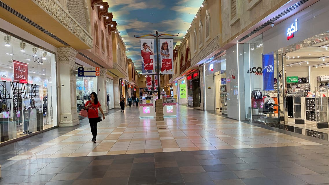 A woman walks in an almost empty mall amid the outbreak of coronavirus, in Dubai. (Reuters)