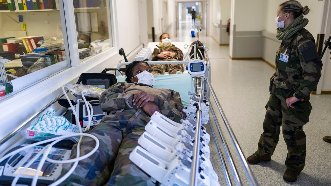 French soldiers take part on March 24, 2020 in a drill at the military field hospital set up outside the Emile Muller Hospital in Mulhouse where the first of 30 COVID-19 patients are expected to arrive.