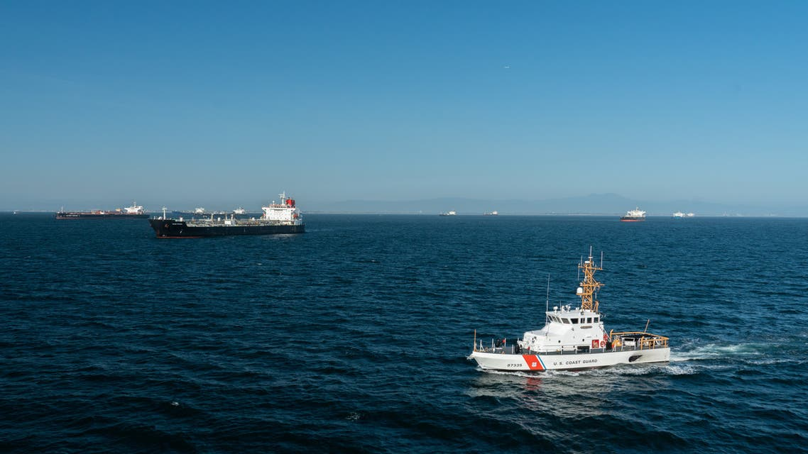 US Coast Guard Cutter Narwhal patrols near some of the 27 oil tankers anchored offshore during the outbreak of the coronavirus in Long Beach, California, on April 23, 2020. (Reuters)