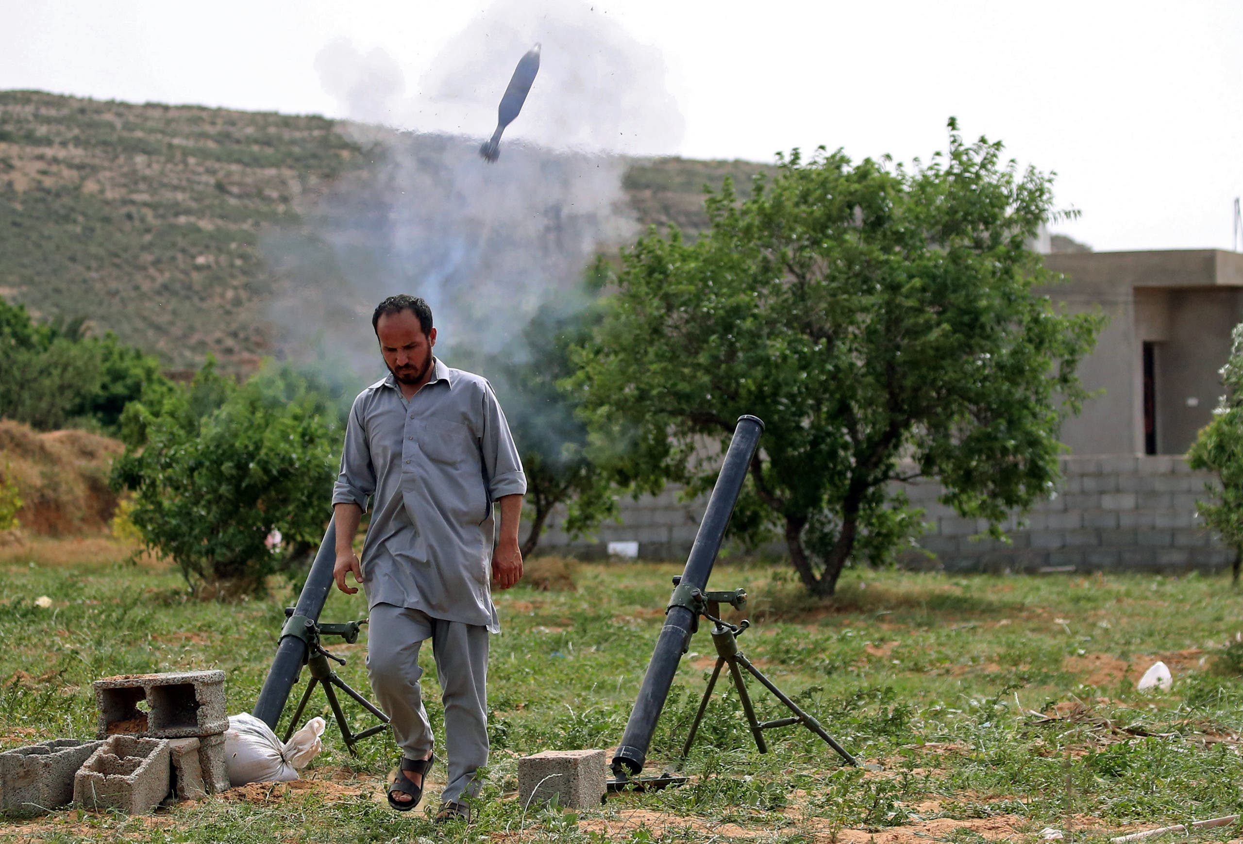 A fighter with Libya's UN-recognised Government of National Accord (GNA) fires rockets from a position near the town of Garabulli toward the city of Tarhuna, southwest of the capital Tripoli (File photo)