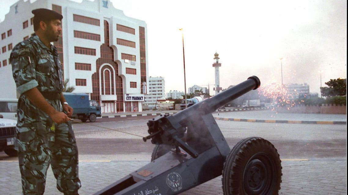 An Emirati policeman fires a cannon to announce the end of a day long of fasting in Sharjah