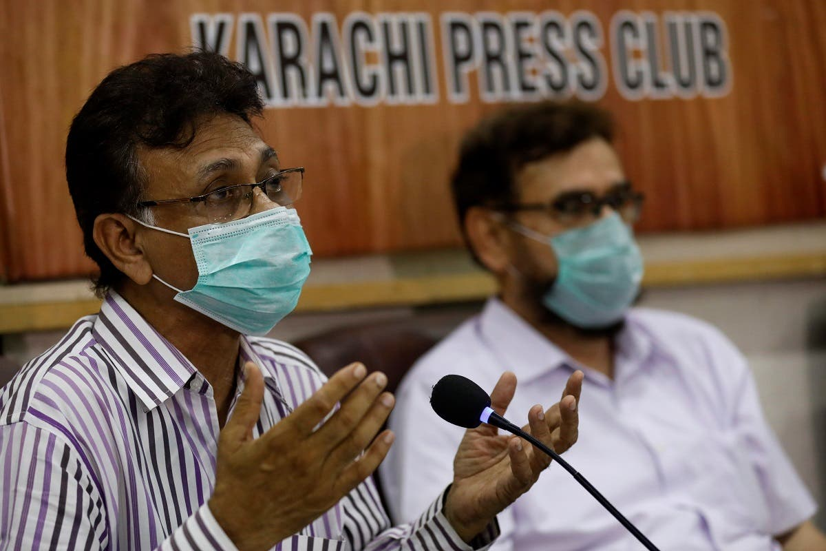 Dr Qaiser Sajjad, secretary-general of the Pakistan Medical Association (PMA) along with other doctors speaks during a news conference in Karachi to appeal government and religious scholars for a strict implementation of the lockdown. (Reuters)