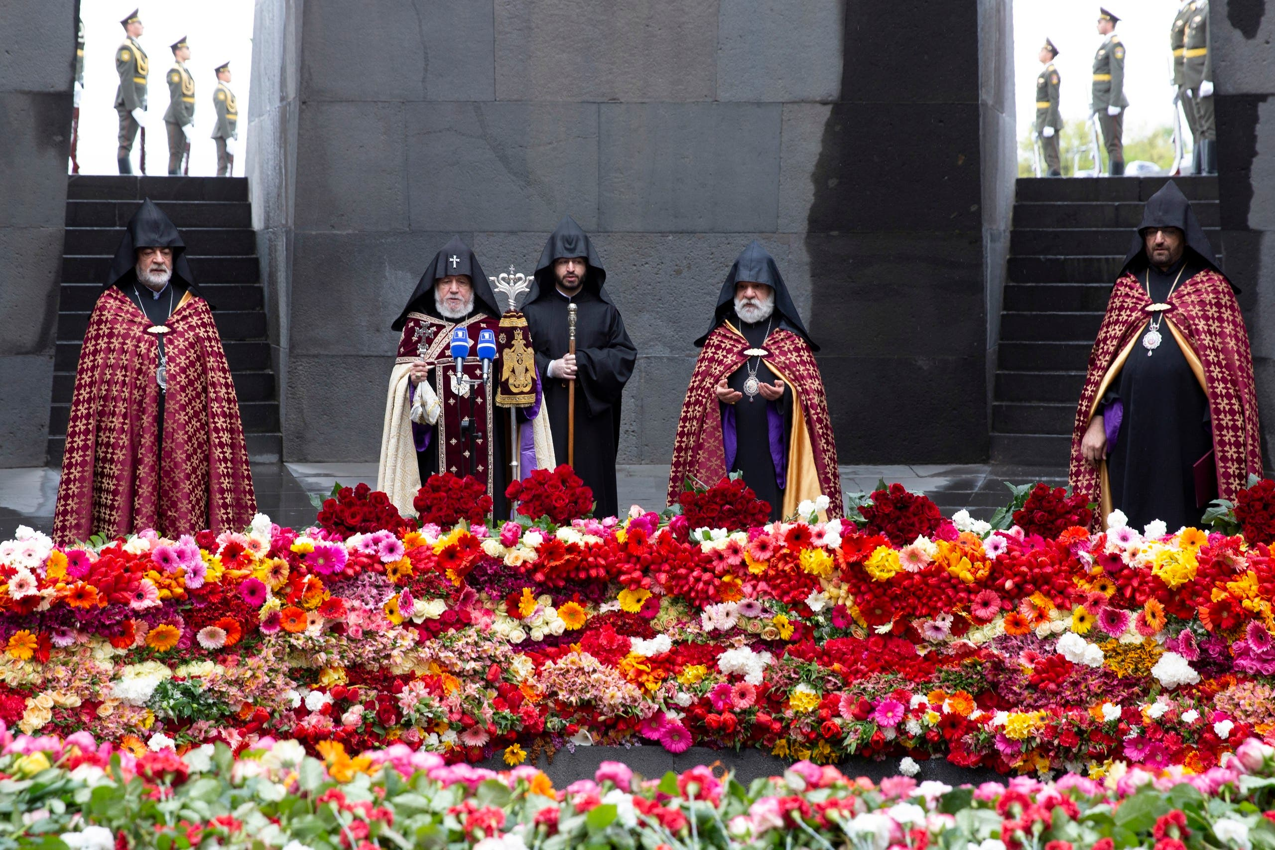 Armenian Apostolic Church leader Catholicos Garegin II, second left, and other Armenian Apostolic Church clerics, observe social distancing guidelines as they attend a memorial service to commemorate the 105th anniversary of the massacre in Yerevan, Armenia, on Friday, April 24, 2020. (AP)