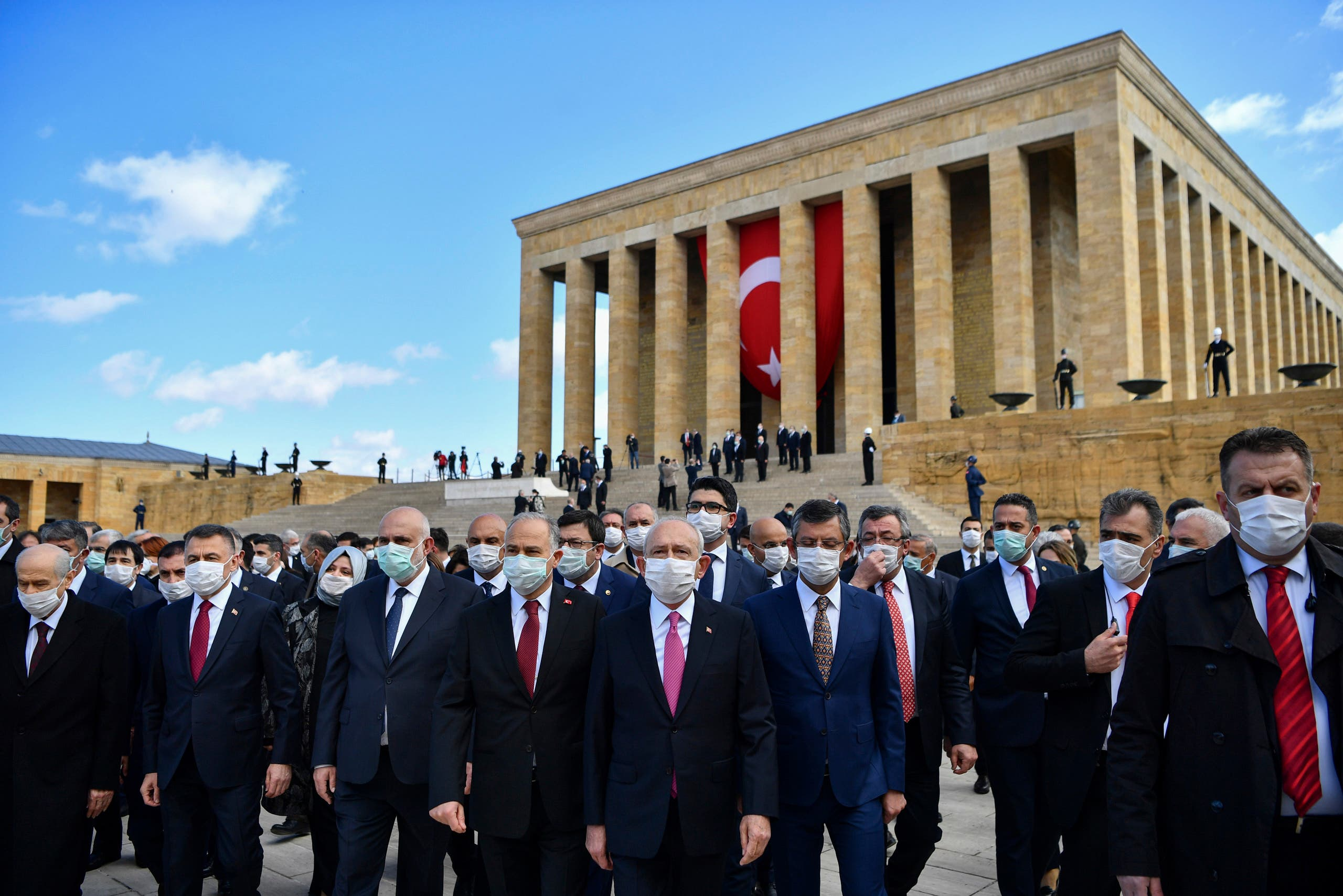 Turkish parliamentarians wearing face masks visit the mausoleum of Turkey's founder Mustafa Kemal Ataturk during a ceremony marking centennial celebrations for the founding of the Turkish parliament, which is also National Sovereignty and Children's Day, in Ankara, Turkey, on Thursday, April 23, 2020. (AP)