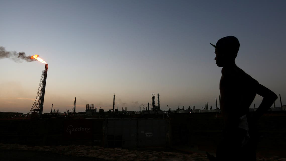 A man stands close to the Cardon refinery which belongs to the Venezuelan state oil company PDVSA in Punto Fijo, Venezuela July 22, 2016. Picture taken July 22, 2016. To match Special Report VENEZUELA-PDVSA/CONTRACT REUTERS/Carlos Jasso