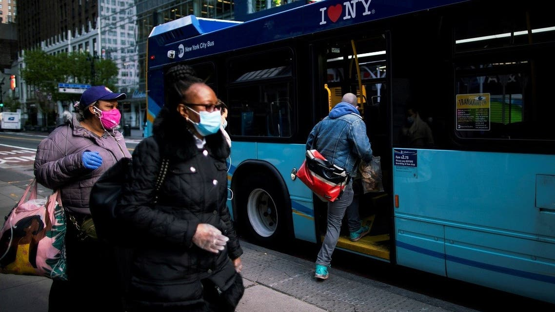 People board an MTA bus by the back door, during the outbreak of the coronavirus in New York City. (File photo: Reuters)