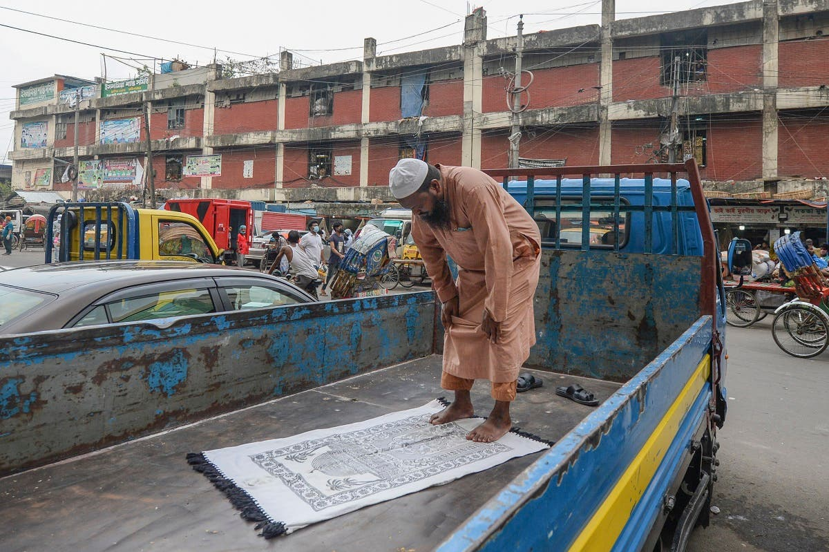 A man offers prayers on a pick-up truck during a government-imposed shut-down as a preventive measure against the COVID-19 coronavirus, in Dhaka. (AFP)