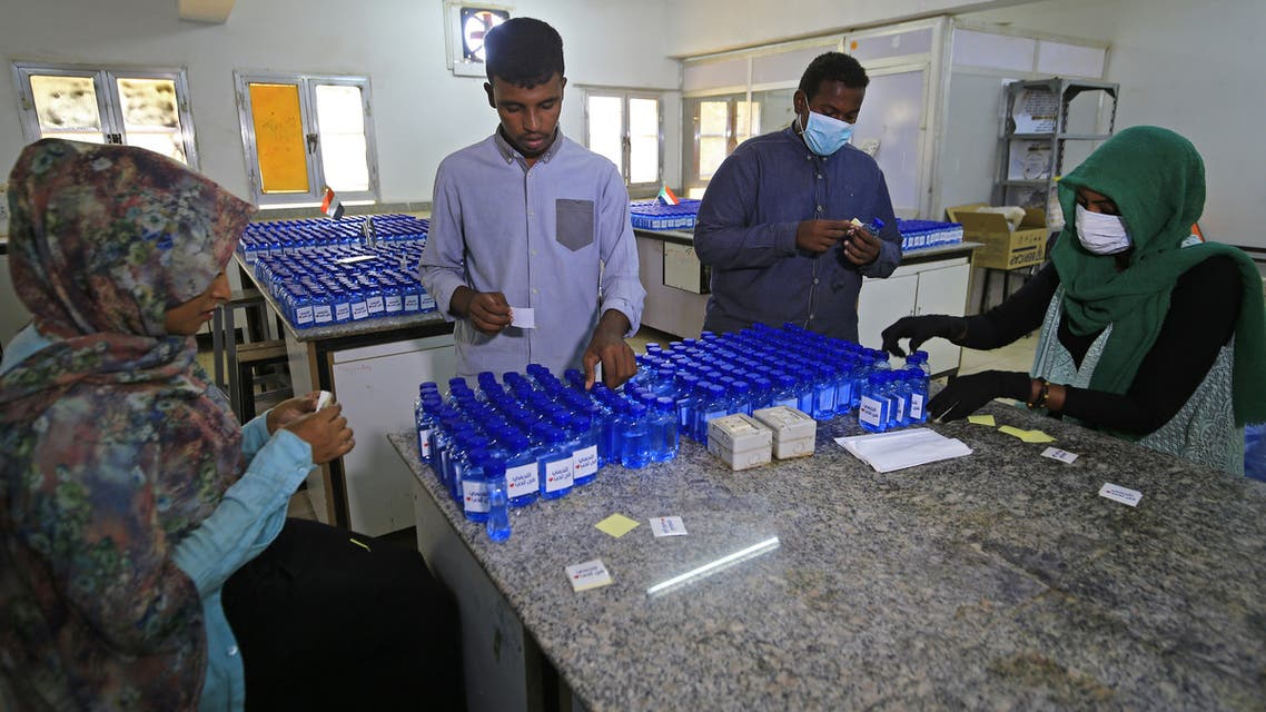 Sudanese medical laboratory students prepare sterilisers to combat the spread of the coronavirus COVID-19, on April 14, 2020 in Khartoum.