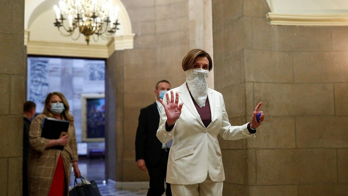 US Speaker of the House Nancy Pelosi (D-CA) wears a face mask as she walks to the House Chamber ahead of a vote on an additional economic stimulus package passed earlier in the week by the US Senate. (Reuters)