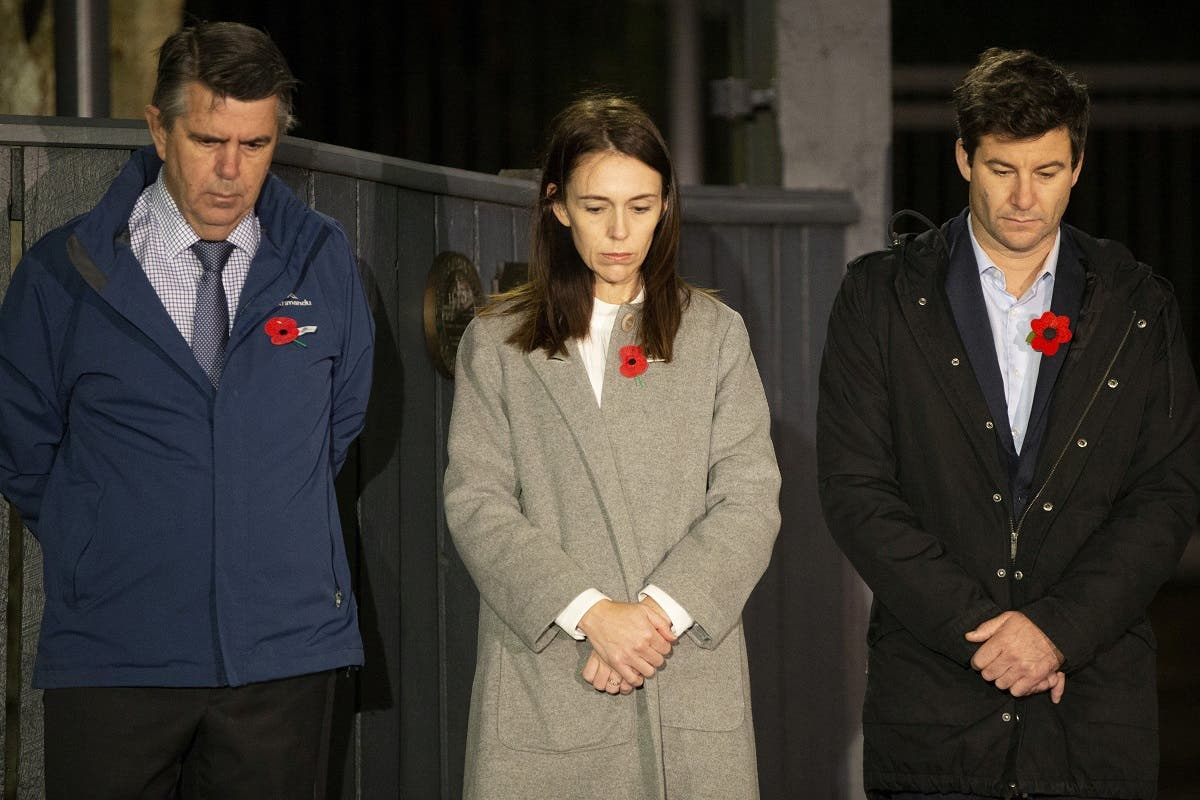 Prime Minister Jacinda Ardern stands at dawn on the driveway of Premier House with her father Ross Ardern (L) and partner Clarke Gayford, in Wellington, New Zealand. (Reuters)