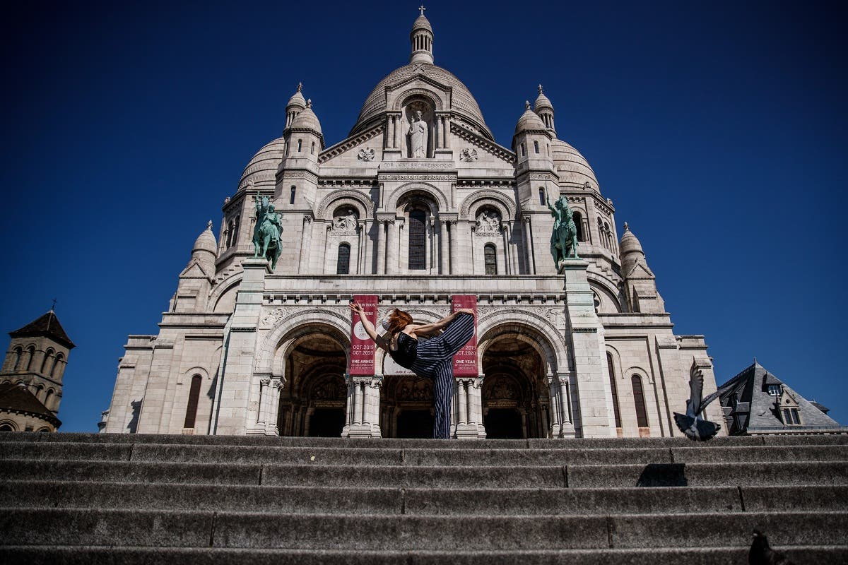 Yara al-Hasbani performs a dance in front of the Sacre Coeur Basilica in Paris on April 22, 2020. (AFP)