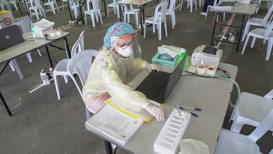 A Kuwaiti doctor prepares her station ahead of the arrival of a planeload of repatriated Kuwaiti citizens at a makeshift field testing center. (File photo: Reuters)