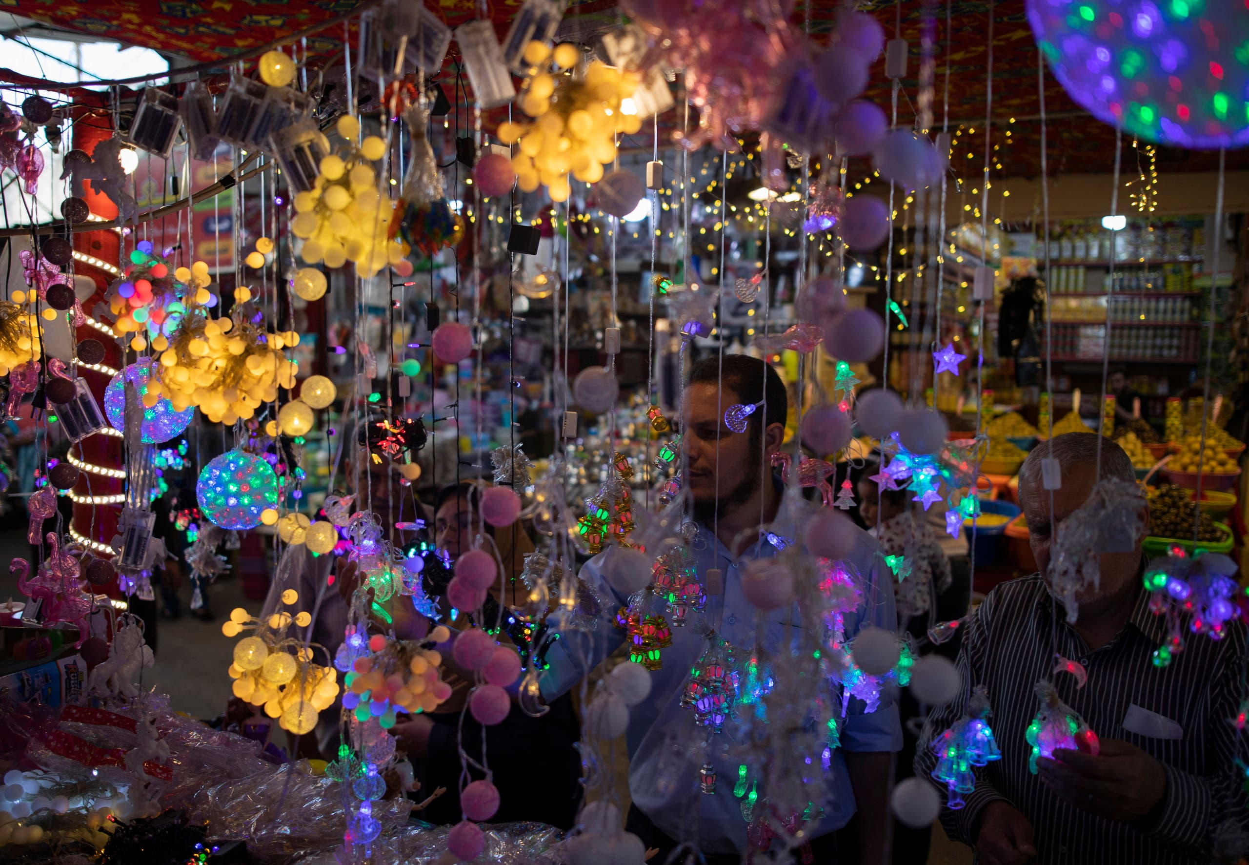 Palestinians buy festive lights in the Zawiya market ahead of the holy month of Ramadan, in Gaza City, on Wednesday, April 22, 2020. (AP)