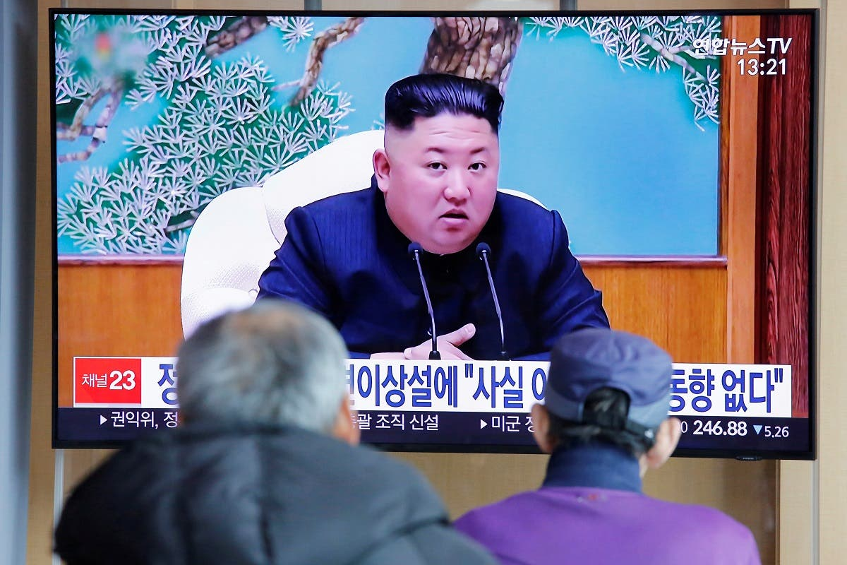 South Korean people watch a TV broadcasting a news report on Kim Jong Un in Seoul, on April 21, 2020. (Reuters)