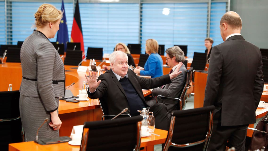 German Interior Minister Horst Seehofer, center, gestures to Finance Minister Olaf Scholz, right, and Minister for Family Affairs, Senior Citizens, Women and Youth Franziska Giffey in Berlin, Germany on March 23, 2020. (AP)