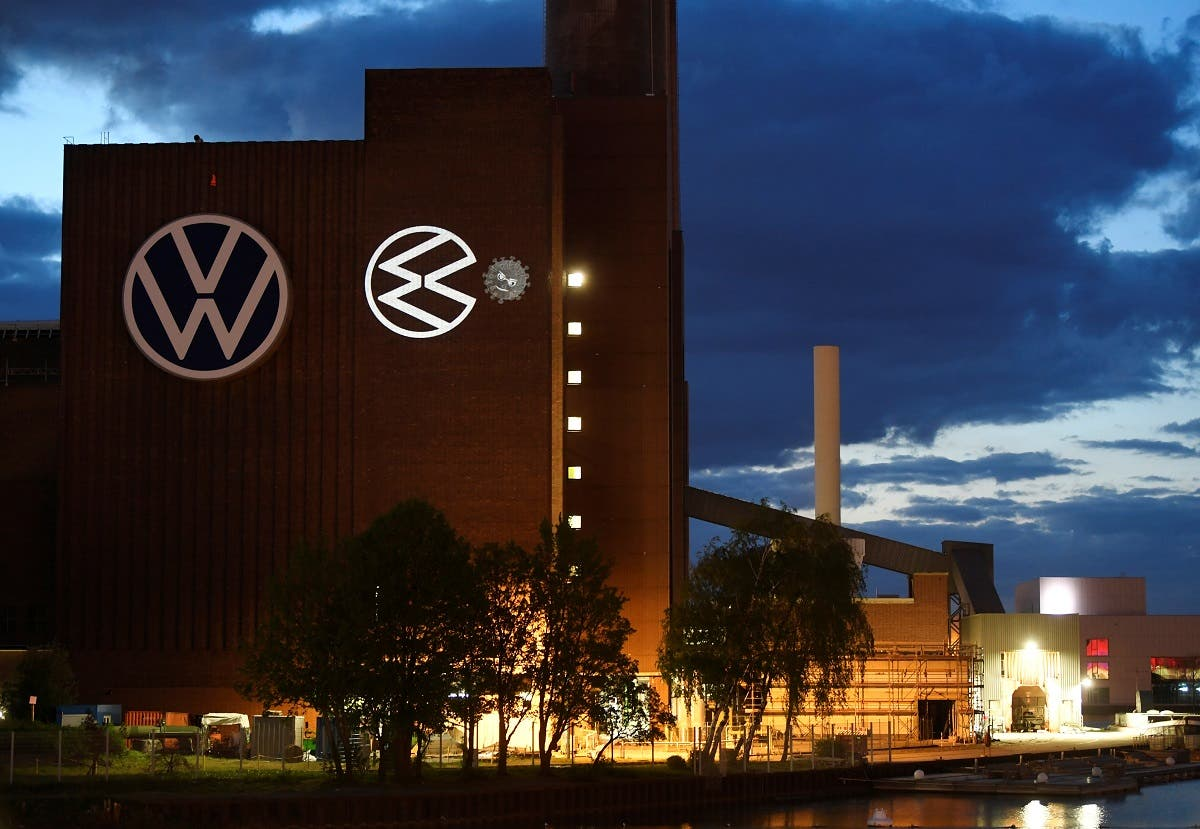 A cartoon of a VW logo squashing the coronavirus is displayed on a building at Volkswagen's headquarters to celebrate the plant's re-opening during the spread of the coronavirus in Wolfsburg, Germany. (Reuters)
