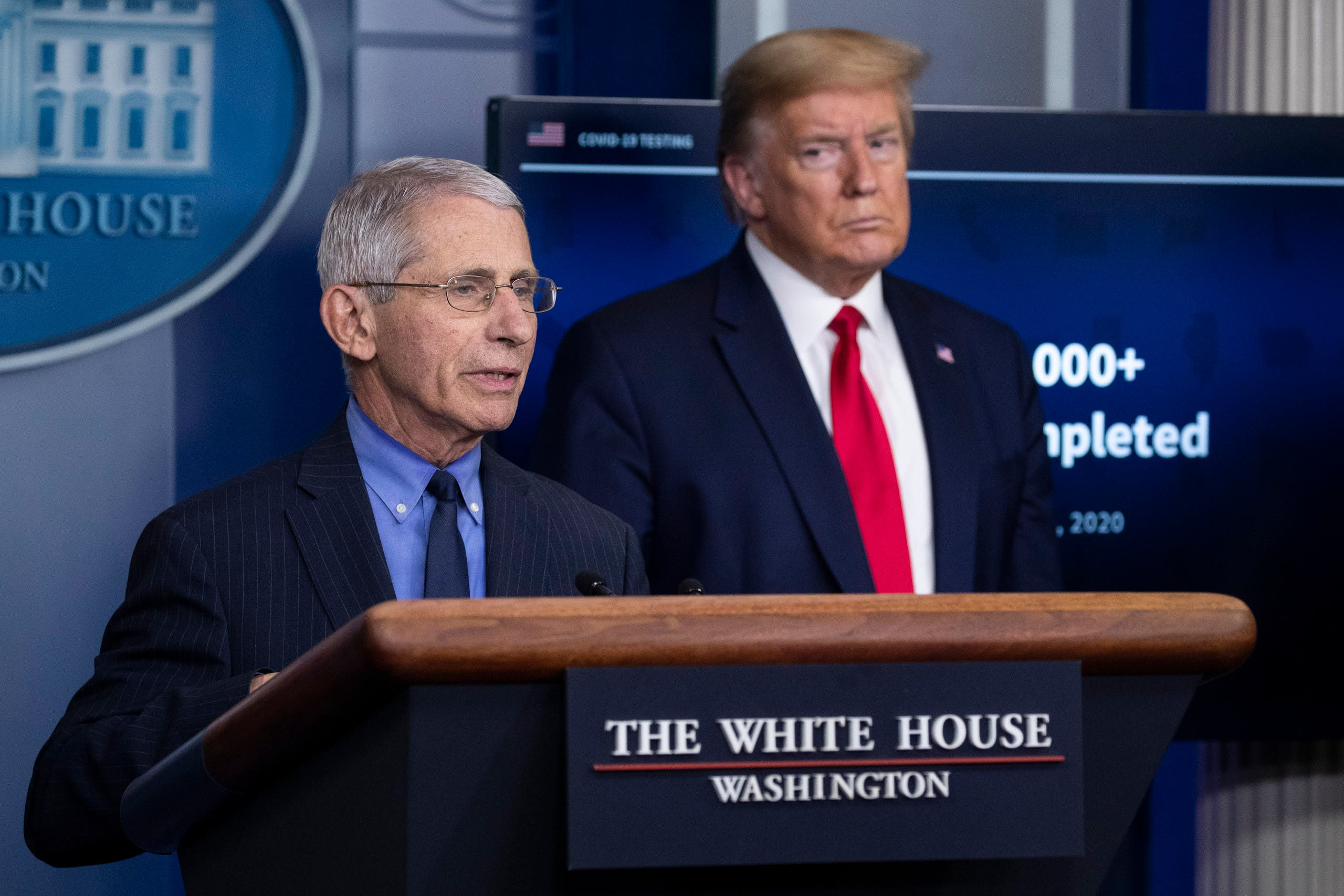 Dr. Anthony Fauci, director of the National Institute of Allergy and Infectious Diseases, about the coronavirus, as President Donald Trump listens, in the James Brady Press Briefing Room of the White House, Friday, April 17, 2020, in Washington. (AP)