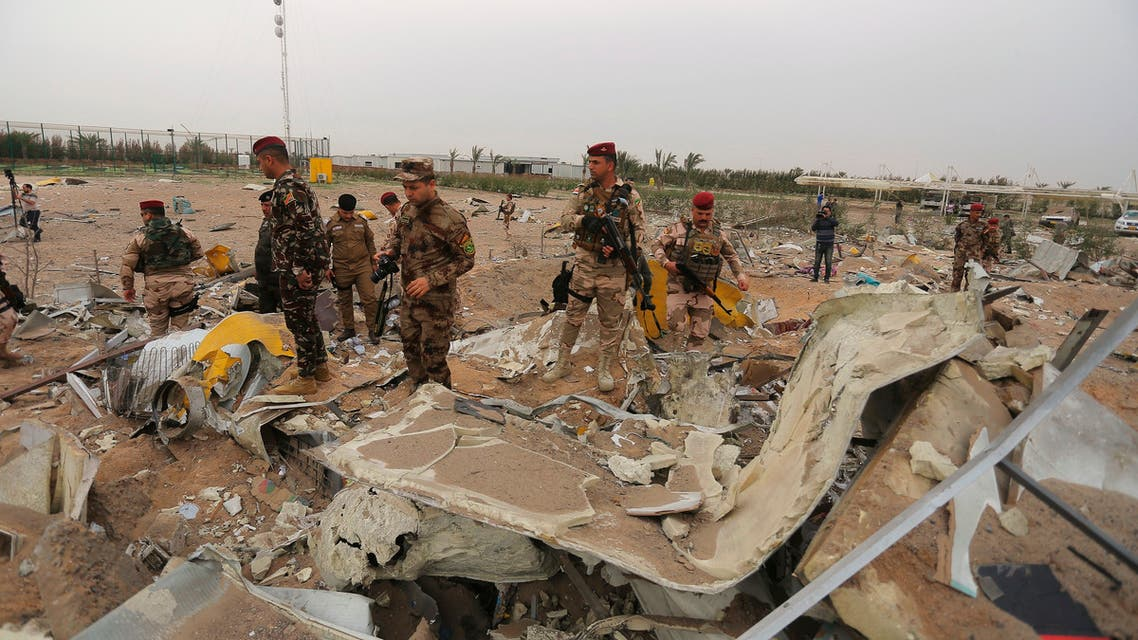Iraqi army soldiers inspect the destruction at an airport complex under construction in Karbala, Iraq, Friday, March 13, 2020. (AP)