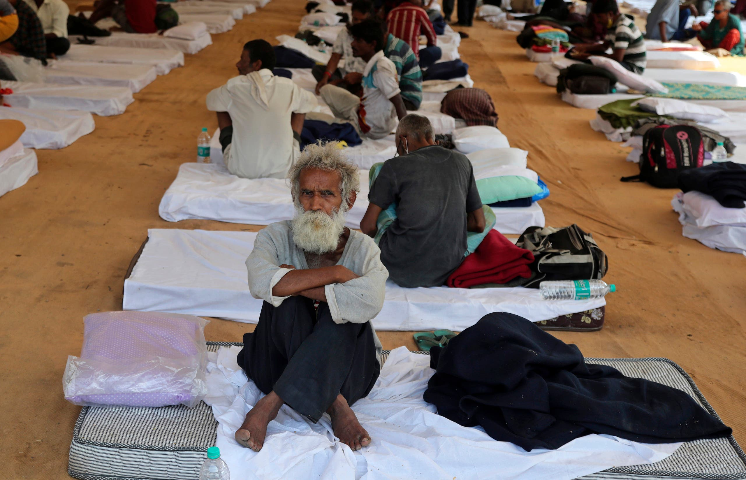 People rest at a shelter set up for migrant workers from other Indian states affected by the coronavirus lockdown in Mumbai, India, on Monday, April 6, 2020. (AP)