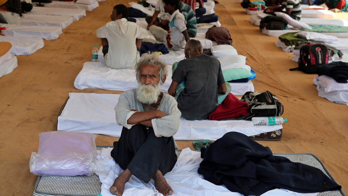 People rest at a shelter set up for migrant workers from other Indian states affected by the coronavirus lockdown in Mumbai, India, Monday, April 6, 2020. (AP)