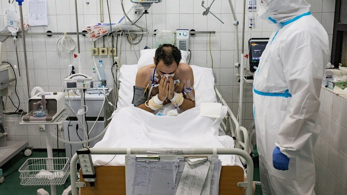 A medical worker treats a patient suffering from the coronavirus disease (COVID-19) inside the Intensive Care Unit at the Hospital for Infectious and Tropical Diseases of the Clinical Center of Serbia in Belgrade. (Reuters)